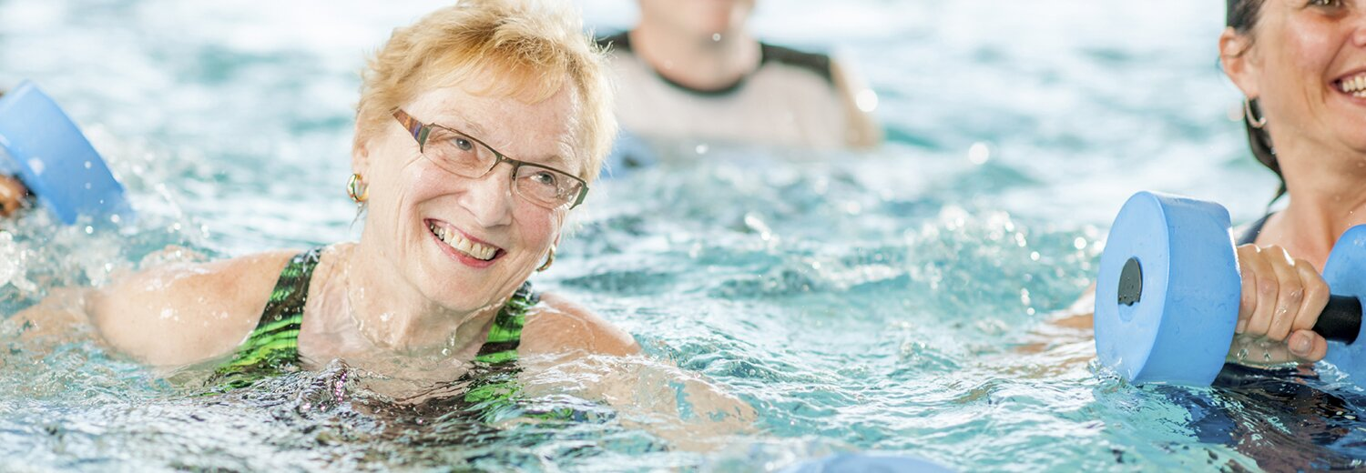 older woman with glasses in pool