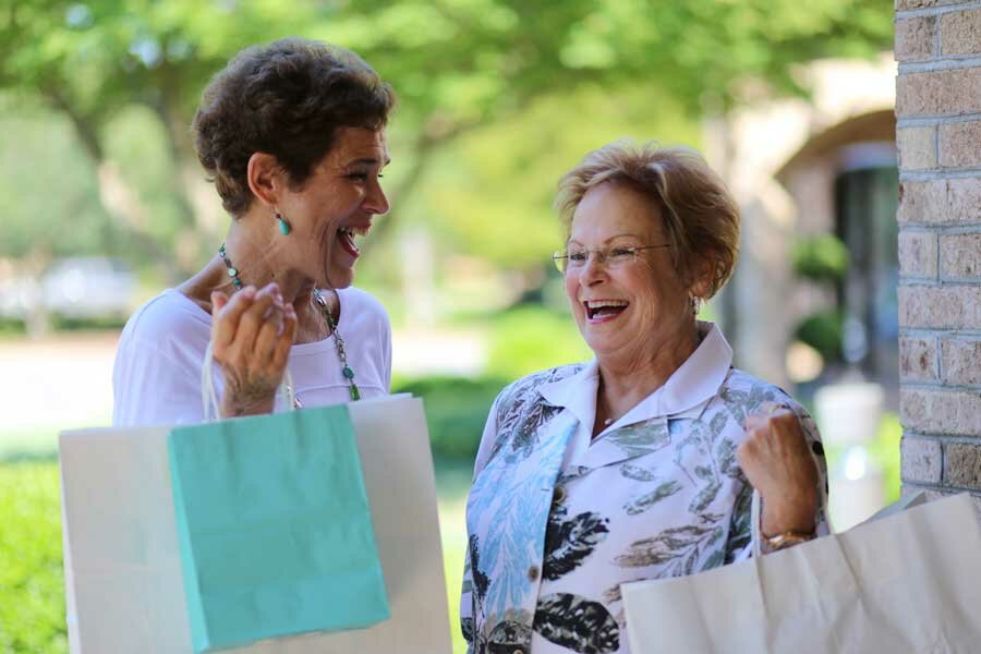 Nan and Kathleen laughing while on a shopping trip
